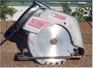 Photo of Roof Cutting Composition Shingles Using an Electric Saw