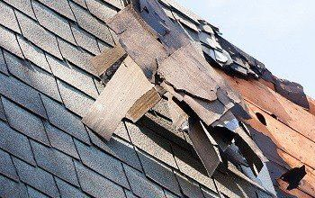 Photo of Wind Damage Causes to Roof Shingles